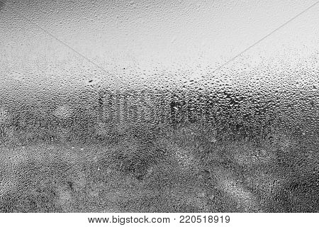 Closeup detail of moisture condensation problem, condensed on the cold window glass