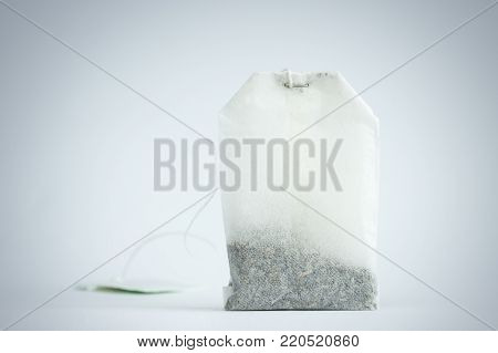 Close-up of an unused tea bag isolated on gray background.