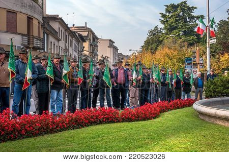 Conegliano, Italy - October 13, 2017: Commemoration ceremony at the monument to the fallen soldiers. Veterans and military are taking part in the event memory for the fallen soldiers. Veterans in the ranks.