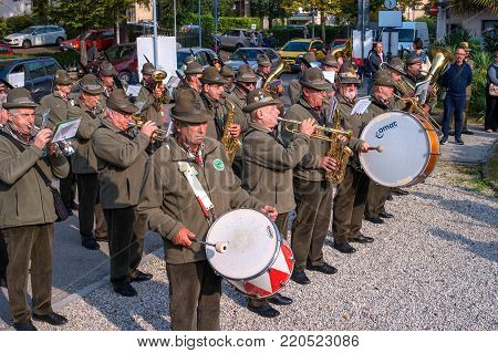 Conegliano, Italy - October 13, 2017: Commemoration ceremony at the monument to the fallen soldiers. Veterans and military are taking part in the event memory. Brass band.