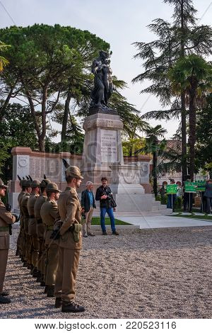 Conegliano, Italy - October 13, 2017: Commemoration ceremony at the monument to the fallen soldiers. Veterans and military are taking part in the event memory. The construction of the monument.