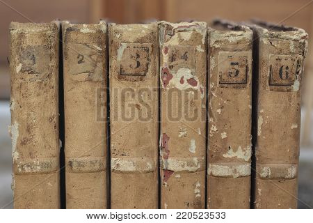 Row of old vintage books closeup old books for background