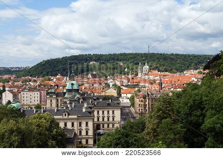 View of old buildings at the Mala Strana District (Lesser Town) and Petrin Hill in Prague, Czech Republic, in the daytime.