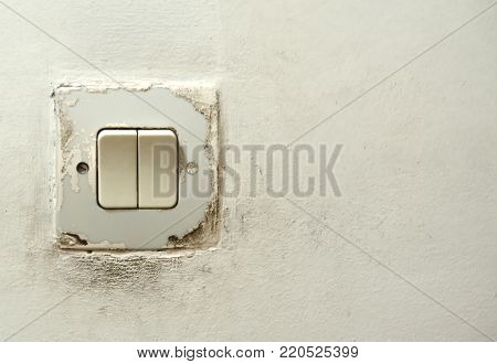 Close up of Light Switch with copy space to the side on wall background. Toggle switch