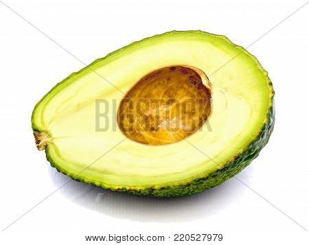 Sliced avocado (Persea americana, alligator pear) isolated on white background