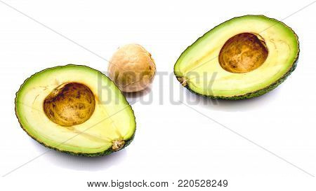 Sliced avocado (Persea americana, alligator pear) with a stone isolated on white background