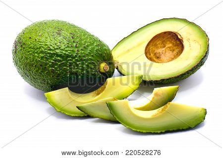 One whole avocado (Persea americana, alligator pear) and its slices isolated on white background