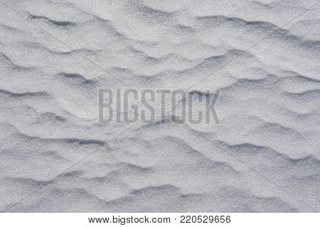 Light, soothing and subtle waves in a crystalline snow drift.  A constant pattern that would not detract from anything written on the top