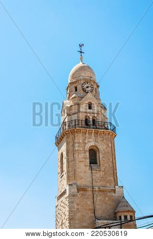 Vertical picture of the clock tower closer to Cathedral of St James, located in Armenian Quarter of Jerusalem, Israel