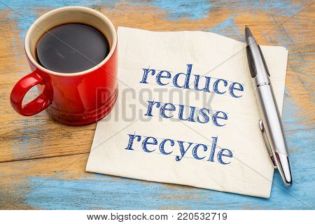 Reduce, reuse, recycle - conservation concept - handwriting on a napkin with a cup of coffee