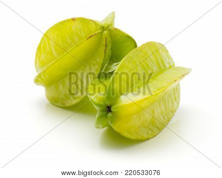 Two whole carambola isolated on white background
