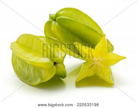Two carambola and one half isolated on white background