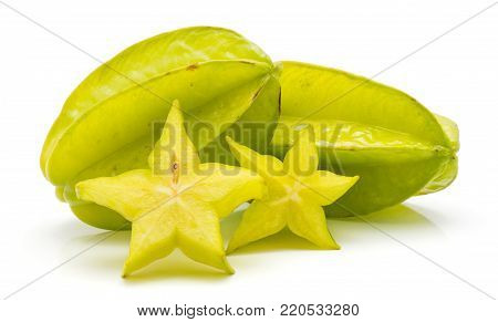 Sliced carambola isolated on white background two star slices and two whole