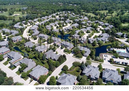 Aerial view of a neighborhood housing complex with ponds in the Chicago suburban city of Northbrook, IL in summer. USA. poster