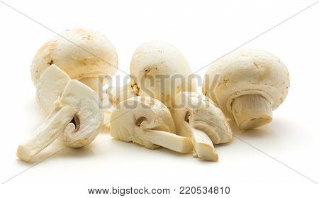 Champignons sliced isolated on white background three whole three quarters
