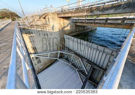 Spillway of Dam gate on morning, The Pa Sak Cholasit Dam Project is one of the major irrigation projects of Thailand,. The dam also decreases problems in Bangkok more flood control