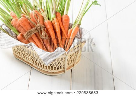 Fresh Carrot, Baby Carrot In Basket On White Wood Background