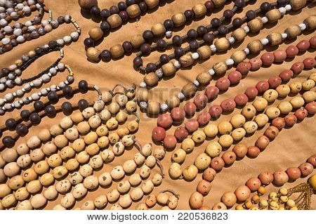 Otavalo, Ecuador-December 23, 2017: artisan indigenous necklaces made of natural seeds and wood