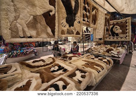 Otavalo, Ecuador-December 23, 2017: indigenous crafts made of alpaca wool for sale in the Saturday artisan market