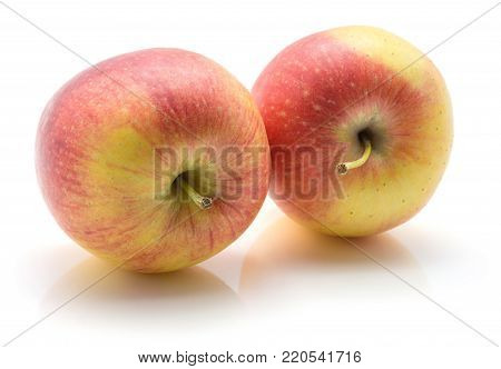 Two apples (Evelina variety) isolated on white background yellow red with stems