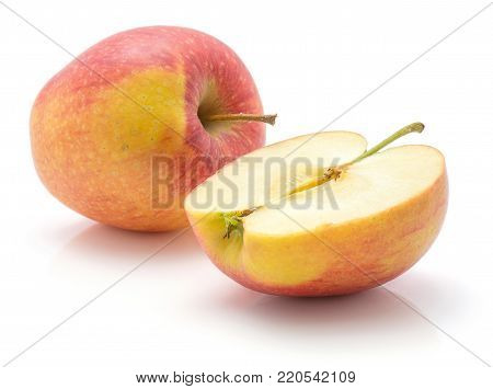 Apples (Evelina variety) isolated on white background one whole red yellow with stem and one half
