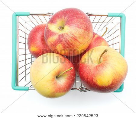 Five apples (Evelina variety) in a shopping basket top view isolated on white background red yellow