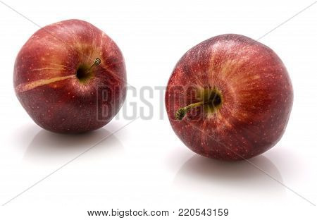 Pair of whole Gala apples isolated on white background