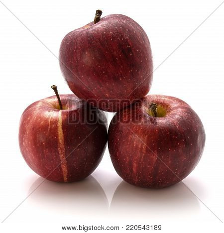 Three whole Gala apples isolated on white background