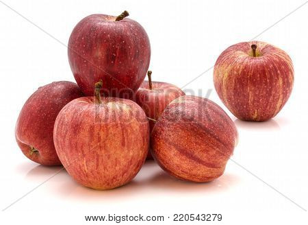 Group of whole Gala apples isolated on white background