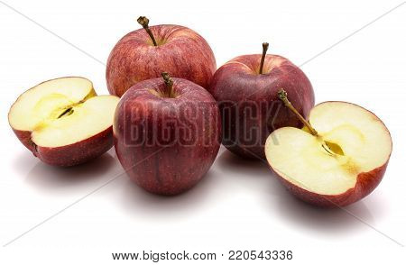 Gala apples, three whole and one cut in half, isolated on white background
