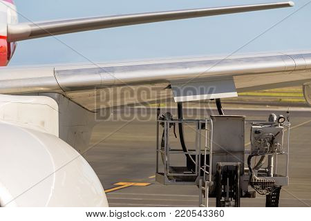Truck Parked Under An Aircraft Wing Refuelling