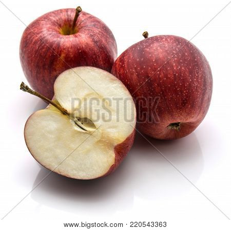 Gala apples, two whole and one half, isolated on white background