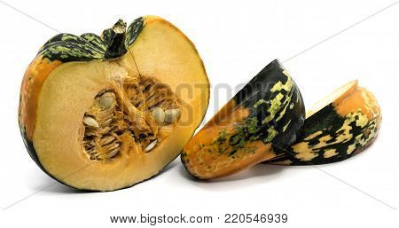 One spotty green yellow pumpkin half with fresh meat and seeds, two slices isolated on white background