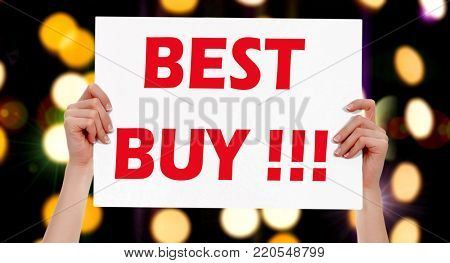 Best Buy! Female hands holding a placard with abstract lights bokeh background. Commercial appeal concept