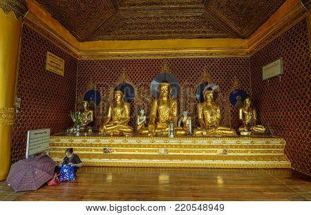 Yangon, Myanmar - Feb 26, 2016. Golden Buddha statues at Shwedagon Pagoda in Yangon, Myanmar. The Pagoda is believed by Buddhists to be around 2500 years old.