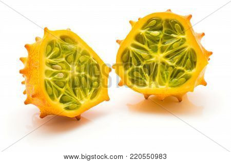 Kiwano cut in half isolated on white background two halves cross section