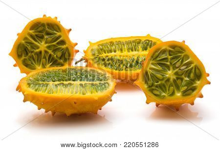 Sliced kiwano isolated on white background two halves cross section comparing
