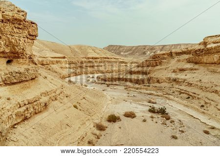 View on judean desert mountains, rocks and sky near the dead sea in Israel. Infinity valley panorama of lone sand, hills and stones. Waterless middle east territory, silence and heat.