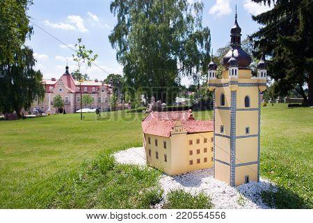 CZECH REPUBLIC, KUNICE - JUN 15, 2015: castle Berchtold from 1877 and park with model miniatures of czech landmarks, Benice, Vidovice village, Czech republic. Model of Melnik castle