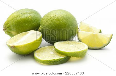 Limes set isolated on white background two whole one half two sliced rings and two slices