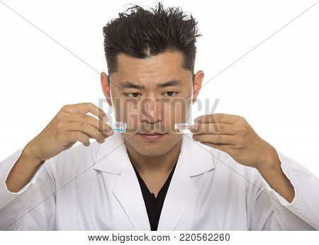 Asian male medical student wearing a lab coat isolated on a white background.  The man is a heathcare worker or an intern.