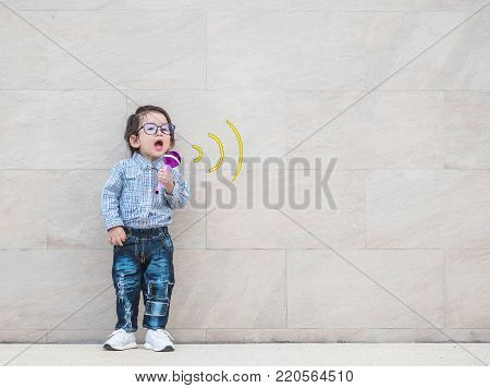 Closeup asian kid with cute medical icon on marble wall textured background in a kid want to be a doctor in a future concept with copy space