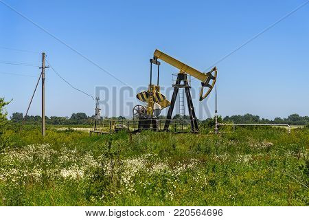 The jack pump stands in the field. North Caucasus.