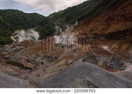 Smoke vents escaping from the earth's surface in Hell Valley (Jigokudani), Noboribetsu, Hokkaido, Japan