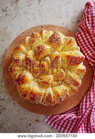 Homemade traditional Balkan pastry dish (Pogaca)  with black caraway and sesame seeds