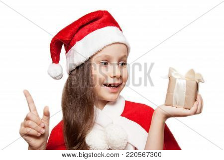 A 7 ears old Little Girl with a Gift in Hand. Christmas or Winter Concept. Isolated.