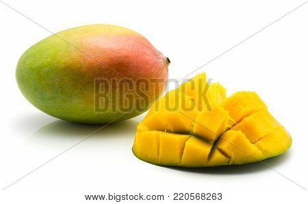Sliced mango hedgehog shape isolated on white background one half and one whole