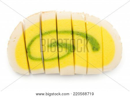 Marzipan isolated on white background pineapple citron taste yellow green one sliced roll seven pieces