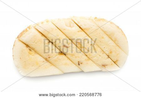 Marzipan sliced in six pieces isolated on white background rum almonds taste
