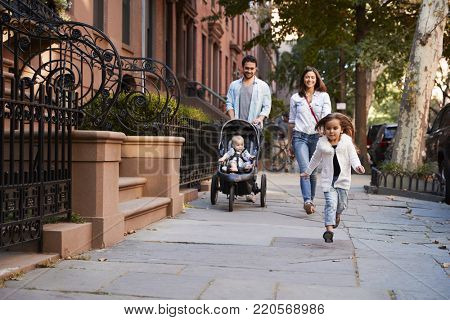 Family taking a walk down the street, close up